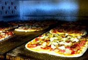 faracis pizza's baking in the oven